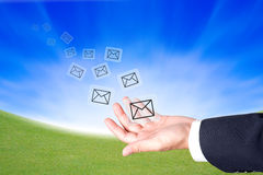 Business hand hold a message icons to sending out Stock Image