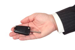 Business hand holding the car's key Royalty Free Stock Photos
