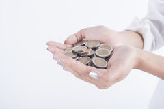 Business hand holding coin money. concept saving finance. And investment Royalty Free Stock Photo