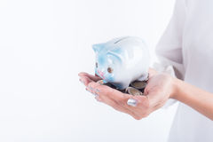 Business hand holding coin and piggy bank. concept saving. Finance and investment Stock Photos