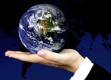Business hand holding a globe Stock Images