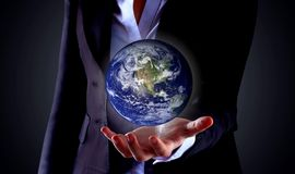 Business hand holding globe Royalty Free Stock Photos