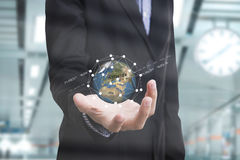 Business hand holding globe earth concept business innovation Stock Image
