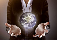 Business hand holding globe Royalty Free Stock Image