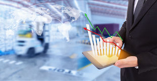 Business hand holding growth chart of transport business stock photography