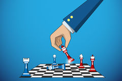 Business hand holding king chess piece to defeat rival, business concept Stock Photos