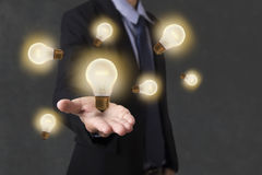 Business hand holding light bulb. concept of new ideas Royalty Free Stock Photo