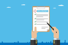 Business hand holding pen with insurance policy on brown clipboard, insurance and business concept Royalty Free Stock Photos