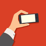 Business hand holding smart phone. Royalty Free Stock Photos