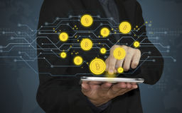 Business hand holding tablet with offer bitcoin on screen. Stock Image