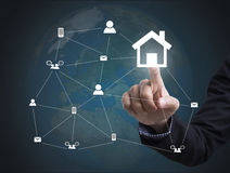 Business hand with home icon networking system. concept globe Stock Photo