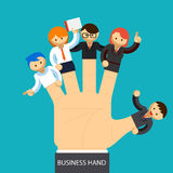 Business hand. Open hand with employee on fingers Royalty Free Stock Photos