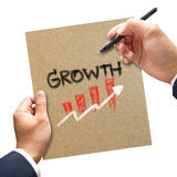 Business hand with pen writing growth on paper concept Royalty Free Stock Images