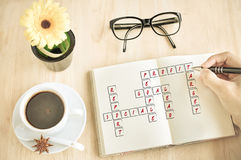 Business hand play crossword Stock Photo