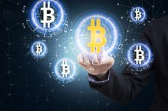 Business hand press offer bitcoin stock on virtual screen. Stock Photo