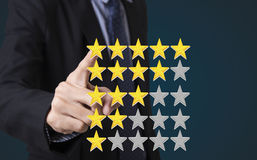 Business hand pressing button check mark five star rating. Business hand pressing yellow marker on five star rating. concept customer service excellent royalty free stock photo