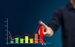 Business hand pressing a growth chart Stock Photo