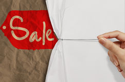 Business hand pull rope open wrinkled paper show sale as concept Royalty Free Stock Images