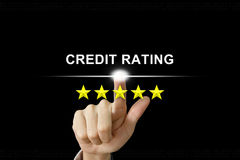 Business hand pushing credit rating on screen Stock Photos