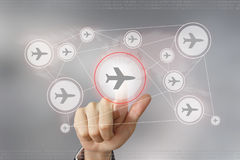 Business hand pushing flight traveling button Stock Photo