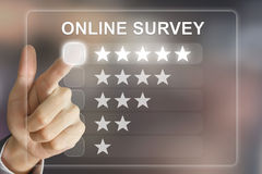 Business hand pushing online survey on virtual screen. Business hand clicking online survey on virtual screen interface stock photo