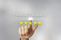 Business hand pushing product quality on screen stock images