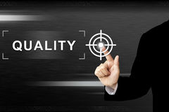 Business hand pushing quality button on touch screen Royalty Free Stock Photography