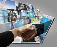Business  hand reaching out from screen laptop shake Hand Stock Images
