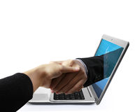 Business  hand reaching out from screen laptop shake Hand Stock Photography