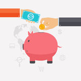 Business hand saving money and coins in a pink piggy bank. Royalty Free Stock Photos