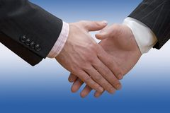 Business hand shake - blue. Business handshake over blue and white background Stock Photos