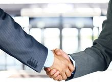 Business hand shake. Closeup of a business hand shake between two colleagues stock photography