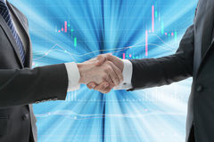 Business hand shake with digital graph. In background Stock Image
