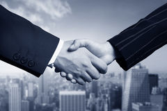 Business hand shake and Manhattan stock images