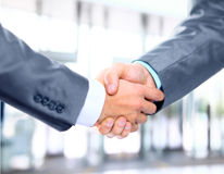 Business hand shake between two colleagues. Closeup of a business hand shake between two colleagues Stock Photos
