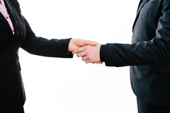Business hand shake between two partners Stock Images
