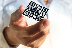 Business hand shows 3d Qr code. Close up of business hand shows 3d Qr code as concept Royalty Free Stock Photo