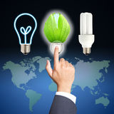 Business hand touch green light bulb Stock Image