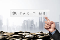 Business hand touching search engine bar with taxes keyword Royalty Free Stock Images