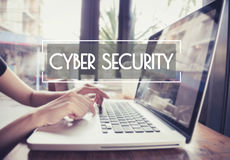 Business hand typing on a laptop keyboard with cyber security. Royalty Free Stock Image