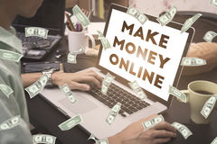 Business hand typing on a laptop keyboard with make money online Stock Photography