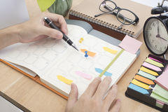 Business hand write calender planner meeting on desk office. Stock Photos