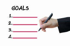 Business hand writing goals Stock Photos