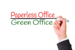 Business hand writing Paperless,Concept for Green office for Save the World. Stock Photos