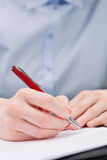 Business Hand Writing or Signing a Document Royalty Free Stock Photography