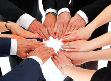 Business hands in a circle (agreement). Business people putting their hands together building a circle (concept for agreement Royalty Free Stock Images
