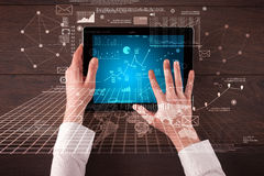Business hands holding tablet Stock Photo