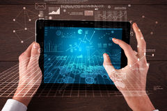 Business hands holding tablet Stock Photography
