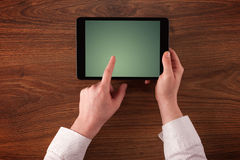 Business hands holding tablet Royalty Free Stock Photography