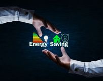 Protecting Energy Saving concept. Business hands protecting Energy Saving concept royalty free stock photography